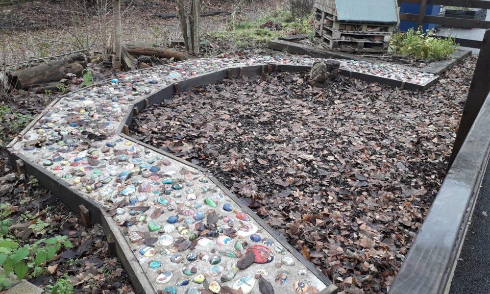 Children's painted pebble path