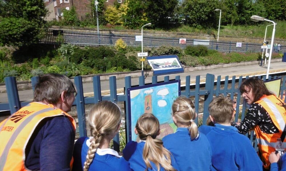 Children admiring their artwork